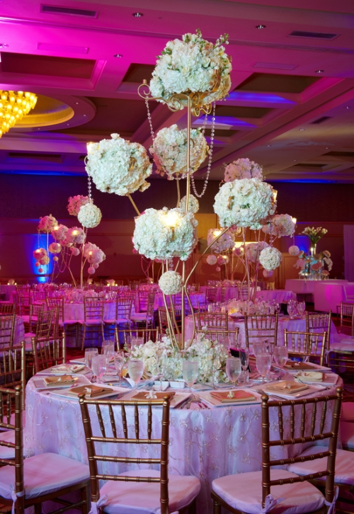 Fuchsia wedding reception with hanging crystal garland