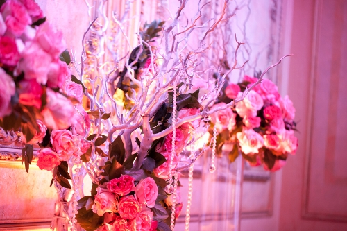 Floral arrangement with hanging crystal garland