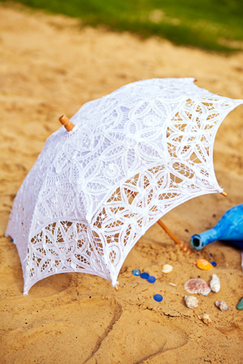 White Parasol on the Beach