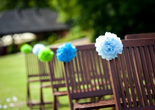 Wedding reception aisle with Tissue Poms