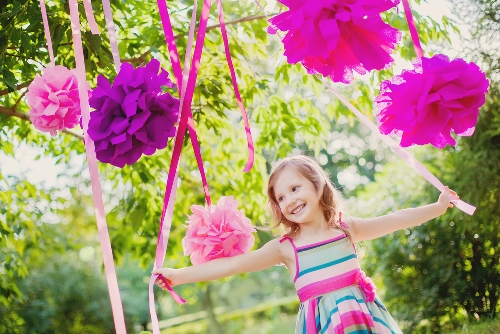 Child playing in Tissue Poms