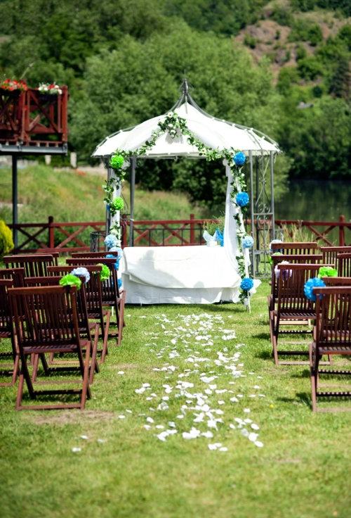 Outdoor wedding decorated in tissue poms