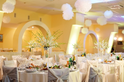 Reception decorated with white tissue poms