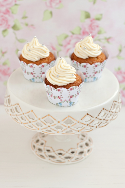 Floral cupcake wrappers on cake stand